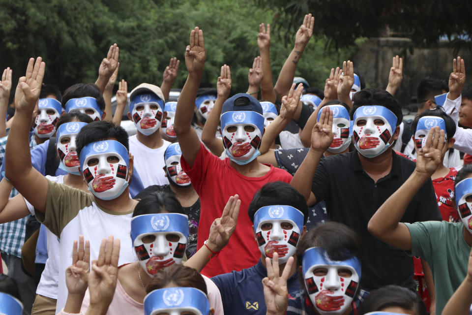 Young demonstrators flash the three-fingered symbol of resistance during an anti-coup mask strike in Yangon, Myanmar, Sunday, April 4, 2021. Threats of lethal violence and arrests of protesters have failed to suppress daily demonstrations across Myanmar demanding the military step down and reinstate the democratically elected government. (AP Photo)