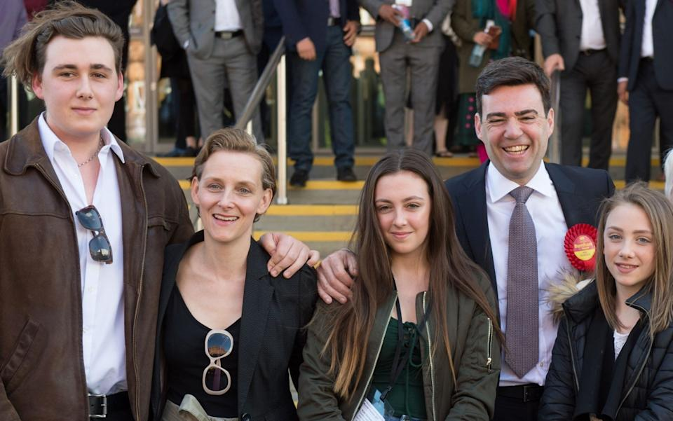 Family man: Andy Burnham with wife Marie-France van Heel and children (L to R) Jimmy, Rosie and Annie - AFP PHOTO / OLI SCARFFOLI SCARFF/AFP/Getty Images