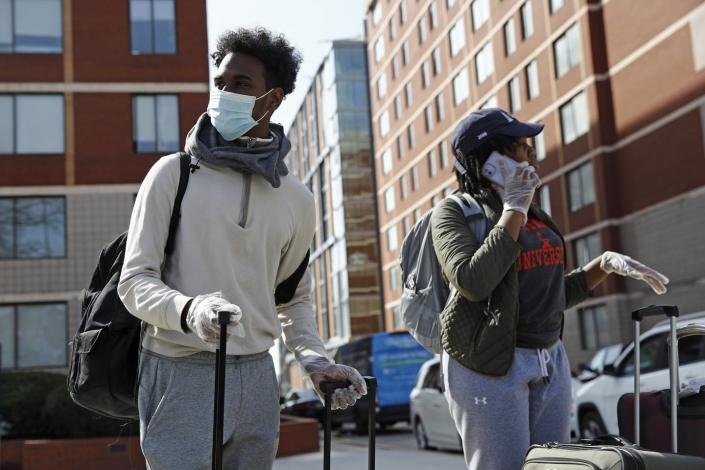 "<span class=""caption"">A Howard University student from Trinidad and Tobago wears a face mask and plastic gloves as he moves out of his dorm room in Washington, D.C. on March 18.</span> <span class=""attribution""><a class=""link rapid-noclick-resp"" href=""http://www.apimages.com/metadata/Index/Virus-Outbreak-Washington-Daily-Life/91b2604378954143afc91b4eab6436cc/6/0"" rel=""nofollow noopener"" target=""_blank"" data-ylk=""slk:AP Photo/Patrick Semansky"">AP Photo/Patrick Semansky</a></span>"