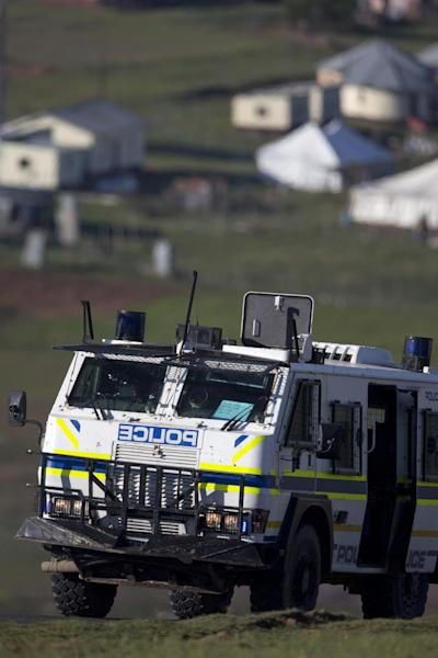 A police vehicle drives up a road prior to the burial of former South African President Nelson Mandela in his hometown Qunu, South Africa, Sunday Dec. 15, 2013. (AP Photo/Peter Dejong)