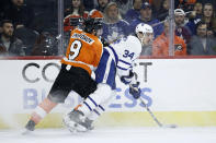 Toronto Maple Leafs' Auston Matthews (34) tries to keep Philadelphia Flyers' Ivan Provorov (9) away from the puck during the first period of an NHL hockey game, Tuesday, Dec. 3, 2019, in Philadelphia. (AP Photo/Matt Slocum)