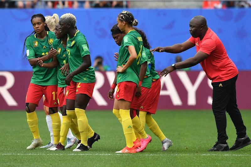 Cameroon coach Alain Djeumfa defended his players for their conduct during their 3-0 defeat against England, saying they had been the victims of an 'injustice' (AFP Photo/Philippe HUGUEN)