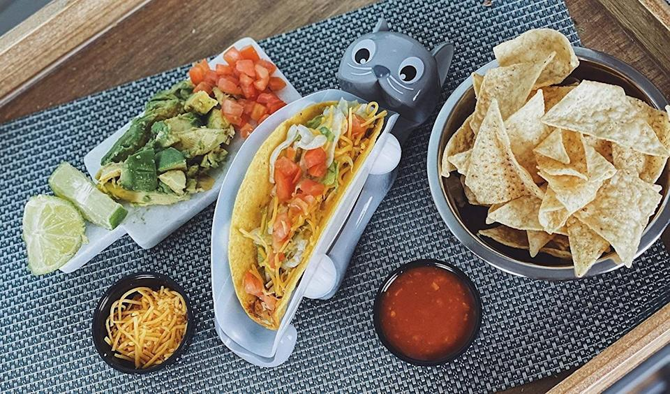 """Prove your fun family has no problem with <i>kitten</i> around when it comes to taco Tuesday.<br /><br /><strong>Promising review:</strong>""""I was hesitant that the cleaning would be a hassle but this is super easy to scrub. It makes dinner easy and more interesting for the kids during quarantine."""" —<a href=""""https://www.amazon.com/dp/B084T52KBF?tag=huffpost-bfsyndication-20&ascsubtag=5871416%2C5%2C27%2Cd%2C0%2C0%2C0%2C962%3A1%3B901%3A2%3B900%3A2%3B974%3A3%3B975%3A2%3B982%3A2%2C16385603%2C0"""" target=""""_blank"""" rel=""""noopener noreferrer"""">Amie</a><br /><br /><strong>Get it from Amazon for<a href=""""https://www.amazon.com/dp/B084T52KBF?tag=huffpost-bfsyndication-20&ascsubtag=5871416%2C5%2C27%2Cd%2C0%2C0%2C0%2C962%3A1%3B901%3A2%3B900%3A2%3B974%3A3%3B975%3A2%3B982%3A2%2C16385603%2C0"""" target=""""_blank"""" rel=""""noopener noreferrer"""">$14.99</a>.</strong>"""