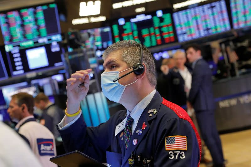 A trader works on the trading floor at the New York Stock Exchange (NYSE) in Manhattan, New York City