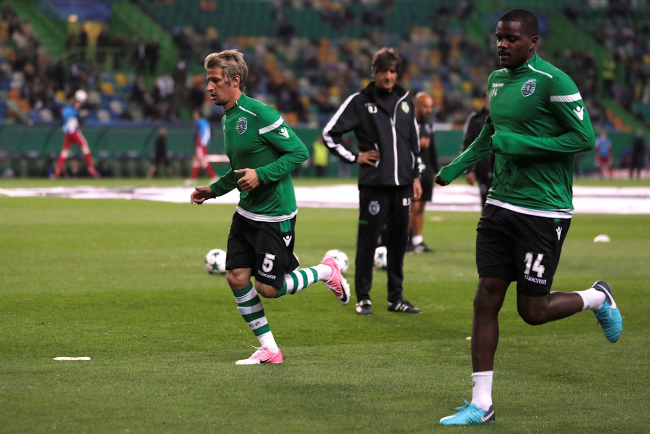 Soccer Football - Champions League - Sporting CP vs Olympiacos - Estadio Jose Alvalade, Lisbon, Portugal - November 22, 2017  Sporting's Fabio Coentrao and William Carvalho warm up before the match    REUTERS/Rafael Marchante