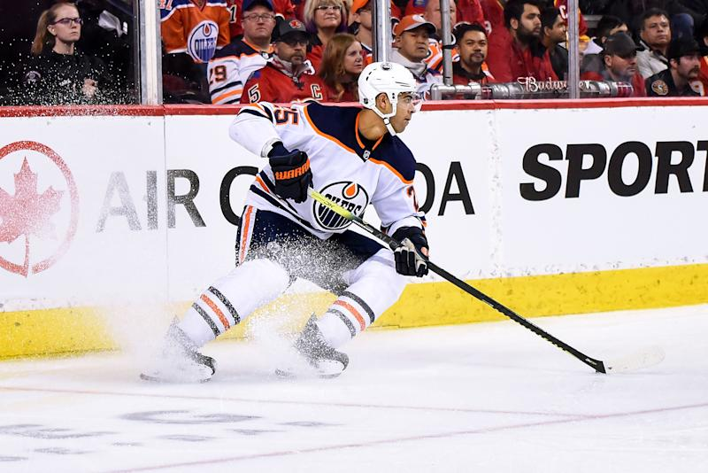 CALGARY, AB - JANUARY 11: Edmonton Oilers Defenceman Darnell Nurse (25) skates with the puck in his zone during the second period of an NHL game where the Calgary Flames hosted the Edmonton Oilers on January 11, 2020, at the Scotiabank Saddledome in Calgary, AB. (Photo by Brett Holmes/Icon Sportswire via Getty Images)