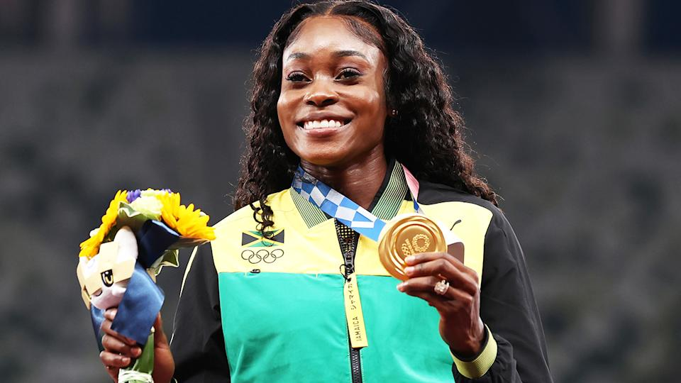 Elaine Thompson-Herah, pictured here with her gold medal after winning the 100m at the Tokyo Olympics.