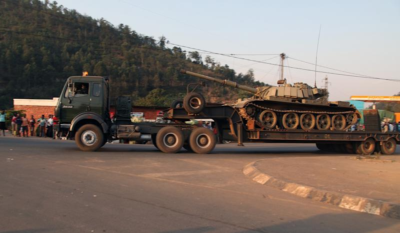 A trailer carrying a tank leaves the Rwandan capital Kigali en route to the border town of Gisenyi Friday Aug. 30, 2013. Rwandan forces on Friday continued to deploy on the border with Democratic Republic of Congo (DRC) after the central African country said it 'could not tolerate' any more violations from its vast neighbour to the west. Trucks carrying heavy artillery and armored tanks started leaving Kigali on Thursday night a few hours after Rwanda's Minister of Foreign Affairs Louise Mushikiwabo said that her country will move to defend her borders after bombs allegedly from the DRC side fell in the western town of Gisenyi, killing two. (AP Photo)
