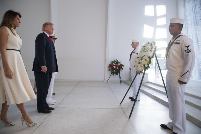 <p>President Donald Trump and first lady Melania Trump, accompanied by Command Commander Adm. Harry Harris, left rear, participate in a wreath laying ceremony at the USS Arizona Memorial, part of the World War II Valor in the Pacific National Monument, in Joint Base Pearl Harbor-Hickam, Hawaii, adjacent to Honolulu, Hawaii, Friday, Nov. 3, 2017. (Photo: Andrew Harnik/AP) </p>
