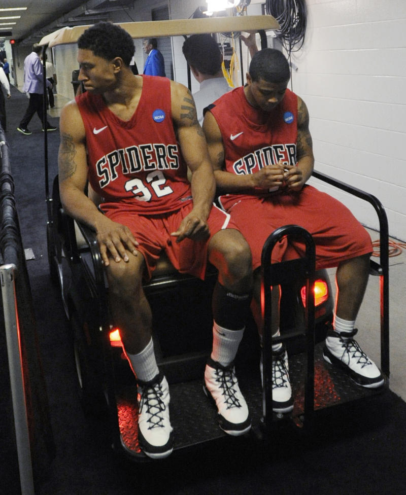 Richmond's Justin Harper, left, and Kevin Anderson head to the locker room after losing to Kansas 77-57 at a Southwest regional semifinal game in the NCAA college basketball tournament Friday, March 25, 2011, in San Antonio. (AP Photo/Michael Thomas)