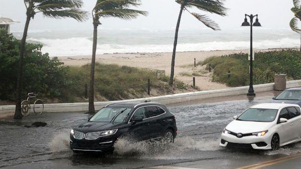 PHOTO: Cars move along flooded highway A1A  in Fort Lauderdale, Fla., Nov. 8, 2020. (Joe Cavaretta/AP)