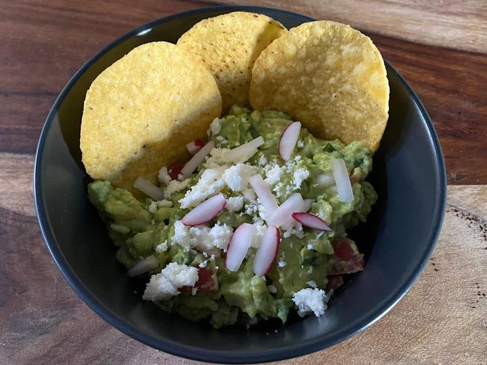 Aaron Sanchez's guacamole recipe with radish, queso fresco, and chips.