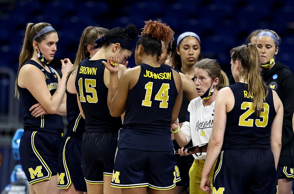 Michigan had a rough ride home after a disappointing NCAA exit. (Elsa/Getty Images)