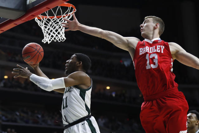 Michigan State forward Aaron Henry drives to the basket past Bradley forward Luuk van Bree, right, during a first round men's college basketball game in the NCAA Tournament, Thursday, March 21, 2019, in Des Moines, Iowa. (AP Photo/Charlie Neibergall)