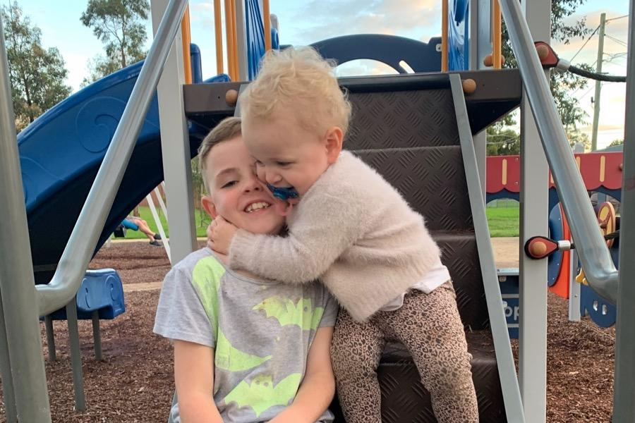 Lola hugs her brother, Ruben, who called triple-0 after she was found dead in Caringbah.
