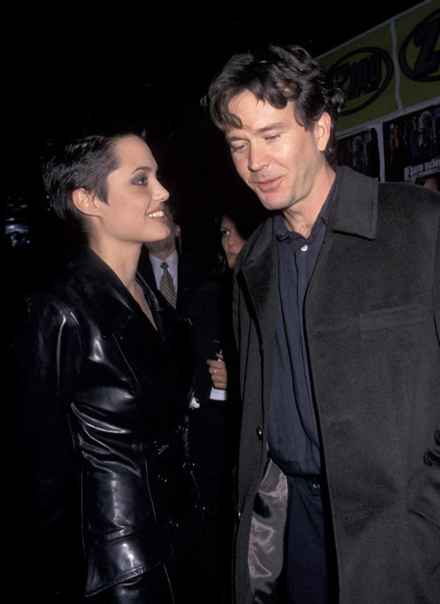 "<p>While Angelina has been linked to many other men (Colin Farrell, Jared Leto, Val Kilmer) — rumors helped along by her own bragging about various <a href=""https://www.today.com/popculture/angelina-jolie-says-she-s-slept-four-men-wbna20893929"" rel=""nofollow noopener"" target=""_blank"" data-ylk=""slk:""lovers"""" class=""link rapid-noclick-resp"">""lovers""</a> — her other serious romance was with Timothy Hutton, who we'll assume is the last one on her list of four men. The timetable there, according to <a href=""http://people.com/archive/early-to-wed-vol-53-no-20/"" rel=""nofollow noopener"" target=""_blank"" data-ylk=""slk:People"" class=""link rapid-noclick-resp""><em>People</em></a> magazine, was when she was separated from Miller around 1997, at the time this photo was taken. They appeared in 1997's <em>Playing God</em> and later in 2006's<em> The Good Shepherd</em>. They dated for a few years, long enough for her to get an ""H"" tattoo, for ""Hutton,"" before parting ways.<br><br>(Photo: Ron Galella, Ltd./WireImage) </p>"