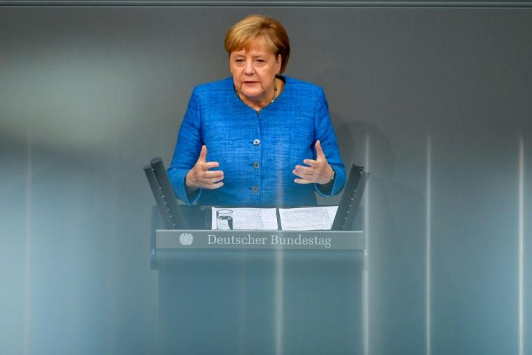 The SPD vote will come as a relief for Merkel, who hopes to stay on as chancellor until her fourth and final term ends in 2021 (AFP Photo/John MACDOUGALL)