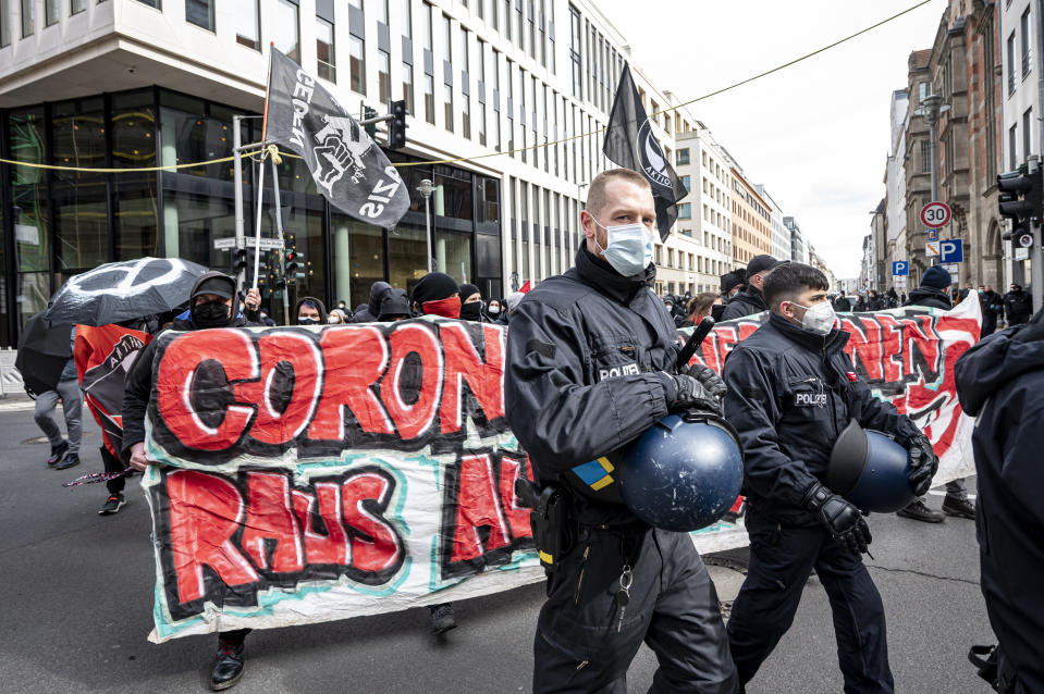 "Various initiatives and left-wing groups demonstrate against a demo of right-wing extremists and so-called ""Reichsbuerger"" in Berlin, Germany, Saturday, March 20, 2021. Right-wing extremists and ""Reich citizens"" are demonstrating around the Brandenburg Gate today. (Fabian Sommer/dpa via AP)"
