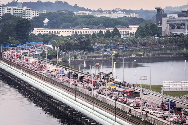 A view of the Johor Causeway. More than 50,000 vehicles use the two crossings daily in what can be described as one of the Johor's busiest border crossings. ― Picture by Hari Anggara