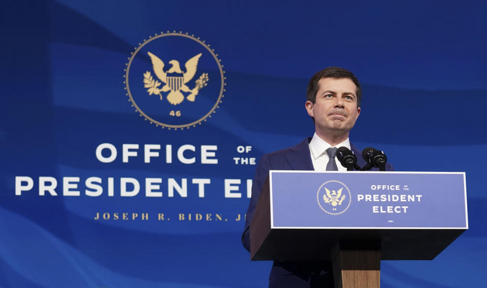 Former South Bend, Ind. Mayor Pete Buttigieg, President-elect Joe Biden's nominee to be transportation secretary, speaks after Biden announced his nomination during a news conference at The Queen theater in Wilmington, Del., Wednesday, Dec. 16, 2020. (Kevin Lamarque/Pool via AP)