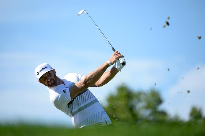 Dustin Johnson tees off on the 13th hole during the first round of the RBC Canadian Open at the Royal Montreal Golf Club on July 24, 2014