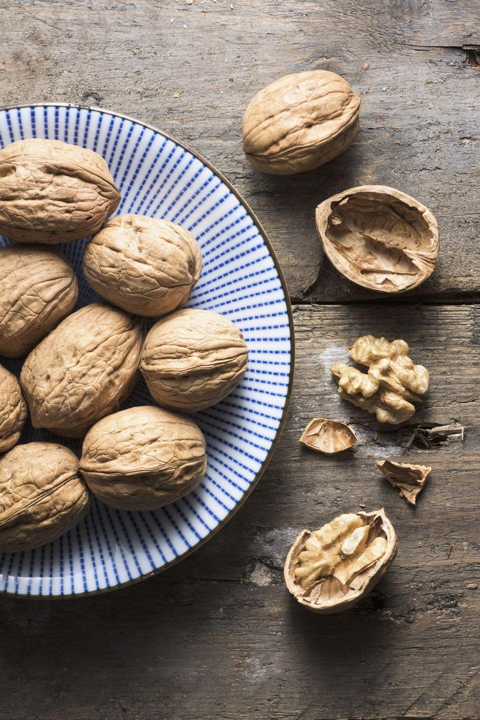 "<p>Eating walnuts regularly was linked with a reduced risk of heart disease, according to data from the <a href=""https://www.ncbi.nlm.nih.gov/pubmed/29145952"" rel=""nofollow noopener"" target=""_blank"" data-ylk=""slk:Nurses' Health Study"" class=""link rapid-noclick-resp"">Nurses' Health Study</a>. Eating as little as one serving of these nuts each week can lower your chances of cardiovascular disease by up to 19%! Consider swapping walnuts for croutons in salads and soups; add 'em to breakfast cereal or yogurt; or nosh on walnuts with fruit to reap the cholesterol-lowering benefits.</p>"