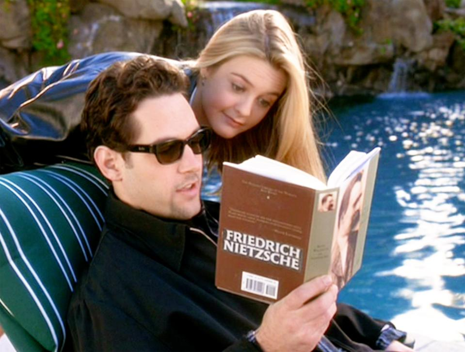 "LOS ANGELES - JULY 21: The movie ""Clueless"", written and directed by Amy Heckerling. Seen here from left, Paul Rudd (as Josh) and Alicia Silverstone (as Cher Horowitz). He reads Friedrich Nietzsche. Theatrical wide release, Friday, July 21, 1995. Screen capture. Paramount Pictures. (Photo by CBS via Getty Images)"