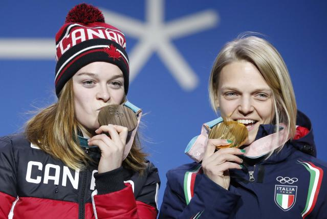 Medals Ceremony - Short Track Speed Skating Events - Pyeongchang 2018 Winter Olympics - Women's 500m - Medals Plaza - Pyeongchang, South Korea - February 14, 2018 - Gold medalist Arianna Fontana of Italy and bronze medallst Kim Boutin of Canada on the podium. REUTERS/Kim Hong-Ji