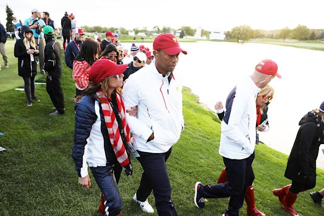 Tiger Woods and Erica Herman were openly affectionate. (Photo: Rob Carr/Getty Images)