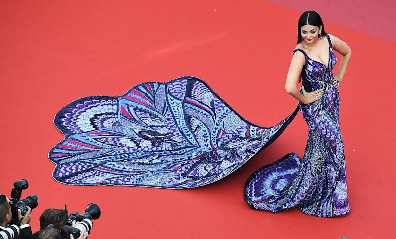 Bollywood star Aishwarya Rai's peacock and butterfly-style gown had the longest train seen on the red carpet (AFP Photo/Anne-Christine POUJOULAT)