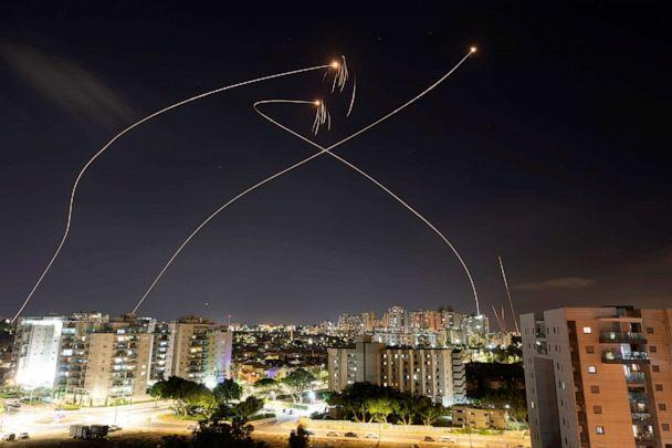 PHOTO: Streaks of light are seen as Israel's Iron Dome anti-missile system intercept rockets launched from the Gaza Strip towards Israel, as seen from Ashkelon, Israel, May 13, 2021.  (Amir Cohen/Reuters)