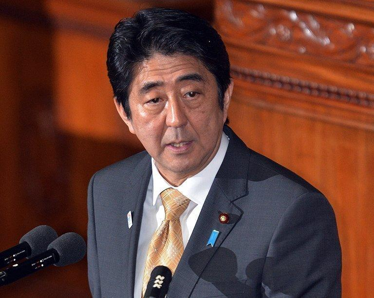 Japan PM Shinzo Abe answers questions during a parliamentary session at the National Diet in Tokyo, on January 31, 2013