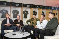 The members of New Zealand Six60, from left, Ji Fraser, Chris Mac, Matiu Walters, Eli Paewai and Marlon Gerbes, speak during a media interview at Eden Park ahead of their concert in Auckland, New Zealand, Friday April 23, 2021. Six60 is being billed as the biggest live act in the world since the coronavirus pandemic struck after New Zealand stamped out the spread of the virus, allowing life to return to normal. On Saturday, the band played a remarkable finale to their latest tour, performing in front of 50,000 people at the first-ever concert at Auckland's Eden Park.(AP Photo/David Rowland)
