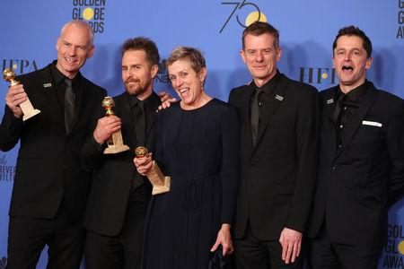 """75th Golden Globe Awards – Photo Room – Beverly Hills, California, U.S., 07/01/2018 – Martin McDonagh (L) poses backstage with cast and producers of """"Three Billboards Outside Ebbing, Missouri"""" after winning for Best Motion Picture - Drama. REUTERS/Lucy Nicholson/Files"""