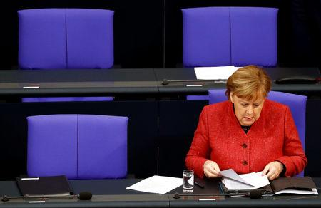 German Chancellor Angela Merkel attends a session at the lower house of parliament Bundestag in Berlin