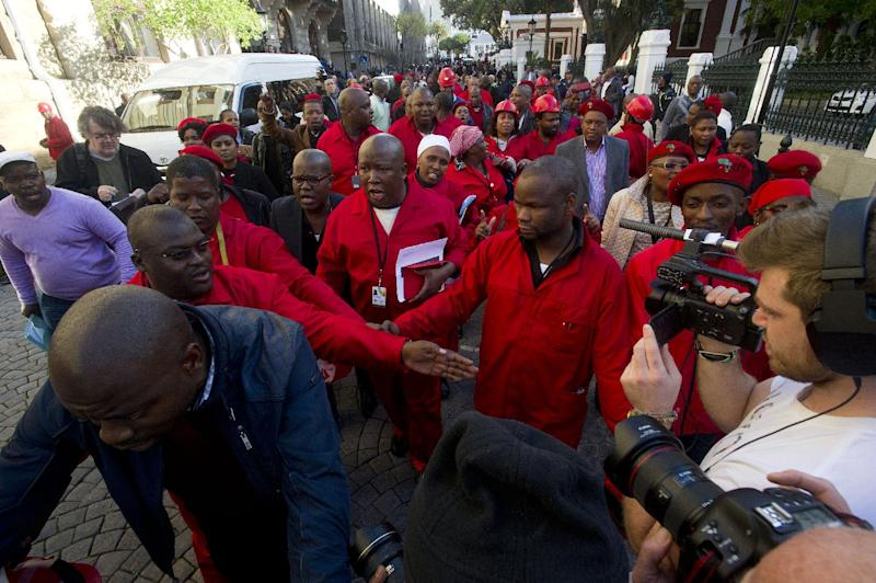 South Africa's Economic Freedom Fighters parliament members and their leader Julius Malema (C) march outside the parliament after being ordered to leave the general assembly in Cape Town on August 21, 2014 (AFP Photo/Rodger Bosch)