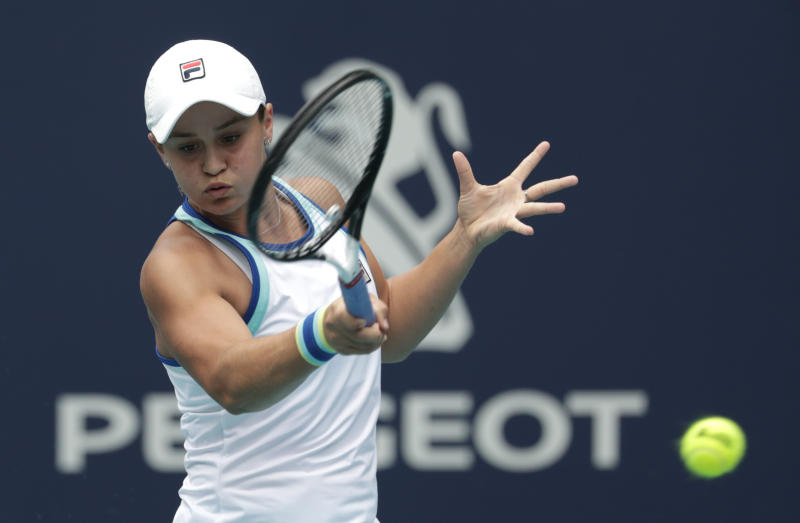 FILE - In this file photo dated Saturday, March 30, 2019, Ashleigh Barty of Australia, returns to Carolina Pliskova of the Czech Republic, during the singles final of the Miami Open tennis tournament, in Miami Gardens, Fla.   Barty beat doubles partner Victoria Azarenka of Belarus 7-6 (2), 6-3 to level their Fed Cup semifinal at 1-1, at Pat Rafter Arena, Australia, on Saturday April 20, 2019. (AP Photo/Lynne Sladky, FILE)