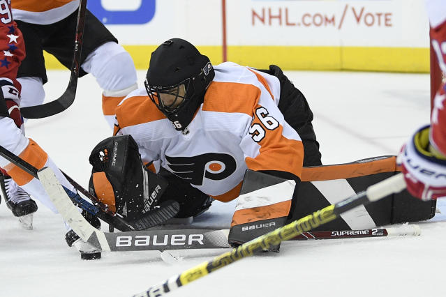 Philadelphia Flyers goaltender Mike McKenna reaches for the puck during the second period of the team's NHL hockey game against the Washington Capitals, Tuesday, Jan. 8, 2019, in Washington. The Capitals won 5-3. (AP Photo/Nick Wass)
