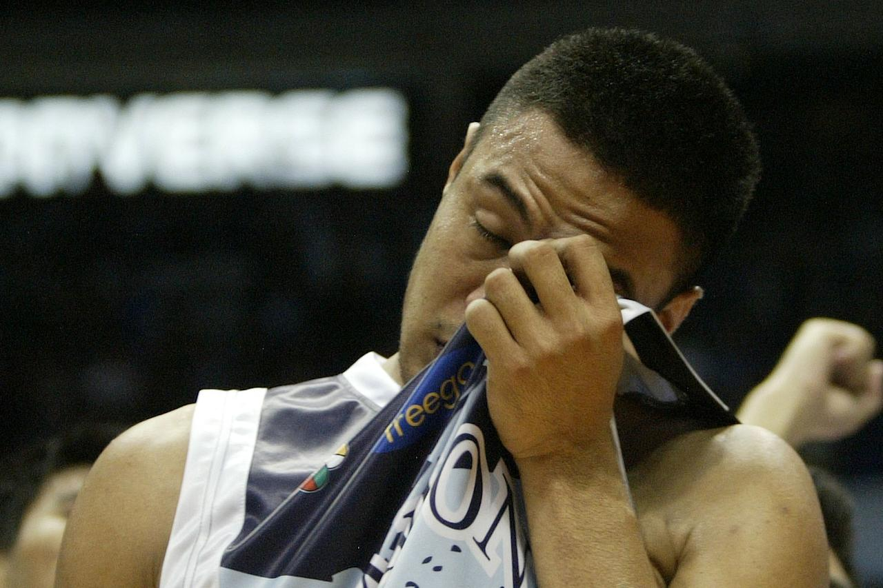 Alex Nuyles seen emotional after the game against Ateneo Blue Eagles in the UAAP Season 74 basketball game held at Smart Araneta Coliseum, Quezon City. (Marlo Cueto/NPPA Images)
