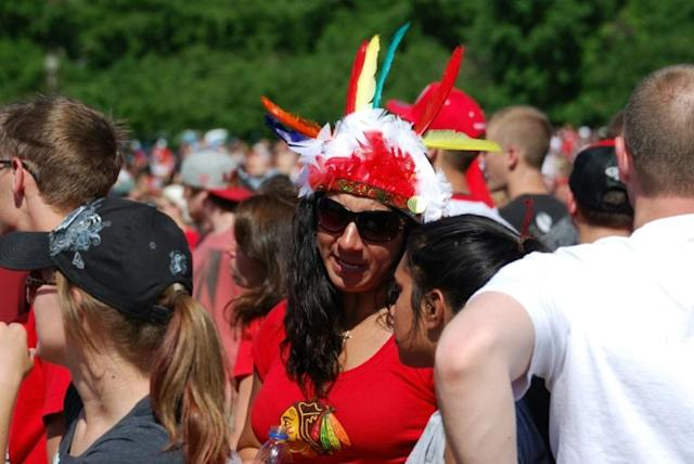 Feather headdresses such as the one being worn by this Chicago Blackhawks fan were banned Wednesday at games and events of the National Hockey League club (AFP Photo/MIRA OBERMAN)