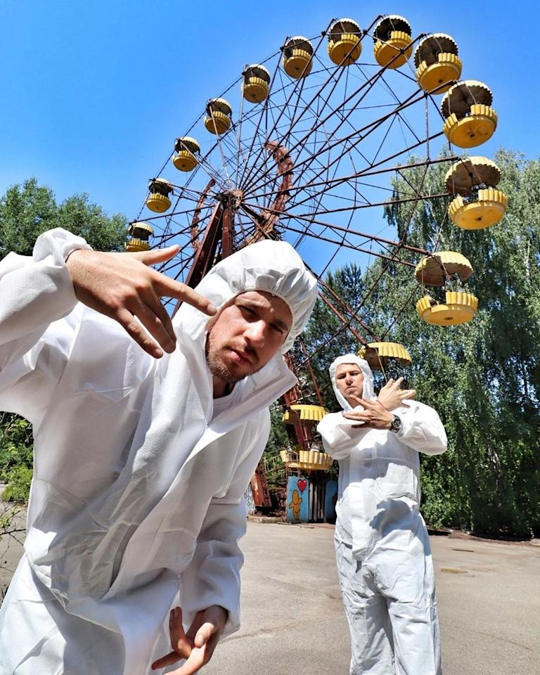 Influencers visit the ferris wheel near the Chernobyl disaster site in June 2019 (and captioned their photo with three radioactive symbol emojis).
