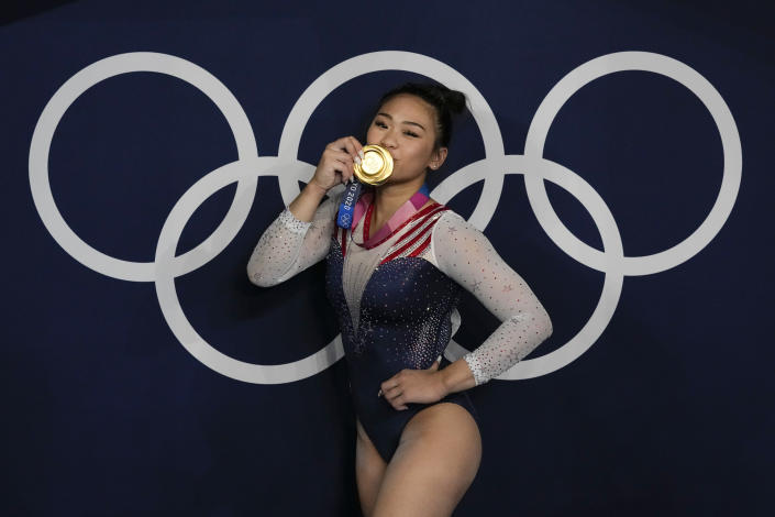 Sunisa Lee, of United States, reacts as she poses for a picture after winning the gold medal in the artistic gymnastics women's all-around final at the 2020 Summer Olympics, Thursday, July 29, 2021, in Tokyo, Japan. (AP Photo/Gregory Bull)