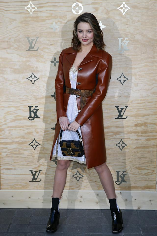 <p>The model dressed up her white lace dress with a chic brown leather coat. <i>(Photo: AP)</i> </p>