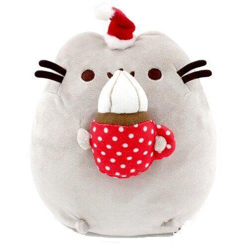 """Fans of Pusheen can't own just one Pusheen. They have to own ALL THE PUSHEENS. This adorable hot chocolate Pusheen is the cutest and your friend will love him/her. <a href=""""https://www.queeniescards.com/product/pusheen-hot-chocolate-plush/"""" target=""""_blank"""" rel=""""noopener noreferrer"""">Get it for $38 at Queenie's Cards.</a>"""