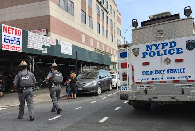 <p>Police walk past an emergency services vehicle next to Bronx-Lebanon Hospital as they respond to an active shooter north of Manhattan in New York on June 30, 2017. (Timothy A. Clary/AFP/Getty Images) </p>