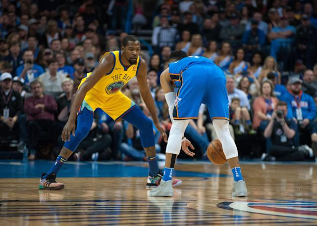 OKLAHOMA CITY, OK - APRIL 03: Golden State Warriors Forward Kevin Durant (35) playing defense Oklahoma City Thunder Guard Russell Westbrook (0) on April 03, 2018 at Chesapeake Energy Arena in Oklahoma City Oklahoma (Photo by Torrey Purvey/Icon Sportswire via Getty Images)