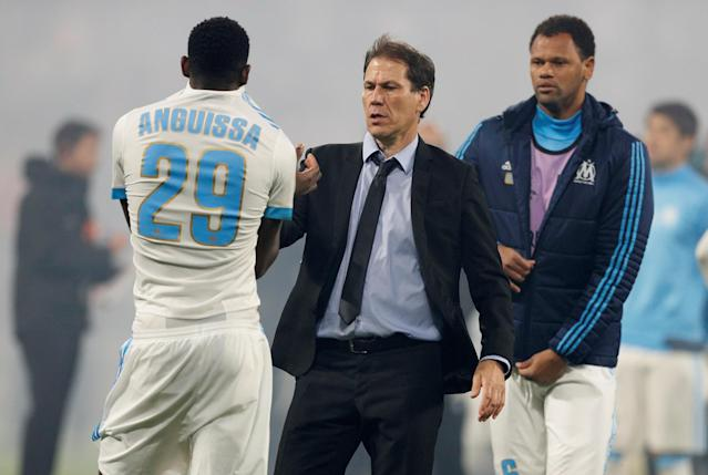 Soccer Football - Europa League Final - Olympique de Marseille vs Atletico Madrid - Groupama Stadium, Lyon, France - May 16, 2018 Marseille's Andre-Frank Zambo Anguissa shakes hands with coach Rudi Garcia after the match REUTERS/John Sibley