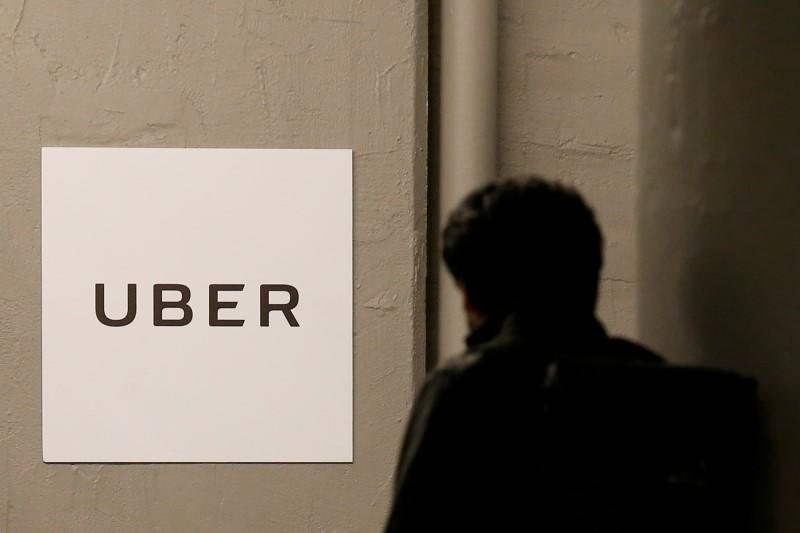 FILE PHOTO: A man arrives at the Uber offices in Queens, New York
