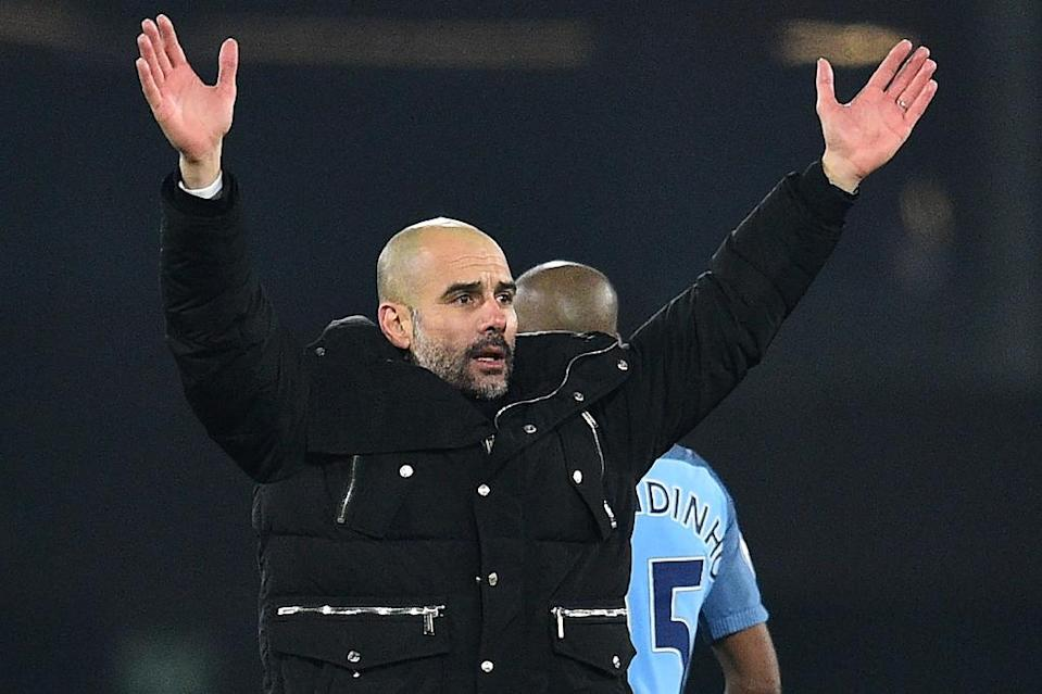 Manchester City's Spanish manager Pep Guardiola celebrates on the pitch after the English Premier League football match between Bournemouth and Manchester City at the Vitality Stadium in Bournemouth, southern England on February 13, 2017 (AFP Photo/Glyn KIRK)
