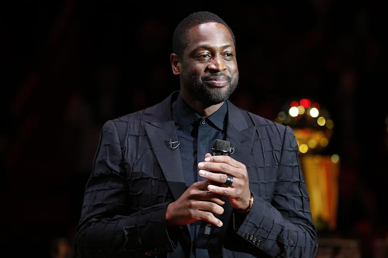 MIAMI, FLORIDA - FEBRUARY 22: Former Miami Heat player Dwyane Wade addresses the crowd during his jersey retirement ceremony at American Airlines Arena on February 22, 2020 in Miami, Florida. NOTE TO USER: User expressly acknowledges and agrees that, by downloading and/or using this photograph, user is consenting to the terms and conditions of the Getty Images License Agreement. (Photo by Michael Reaves/Getty Images)